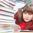 Schoolgirl, schoolwork and stack of books — Stock Photo #37712331