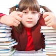 Schoolgirl, schoolwork and stack of books — Stock Photo #37712335