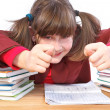 Schoolgirl, schoolwork and stack of books — Stock Photo #37712353
