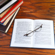 Open book on wooden table — Stock Photo