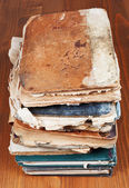 Antique books on wooden table — 图库照片