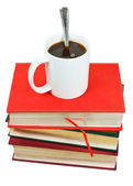 Mug of coffee on stack of books — Stock fotografie