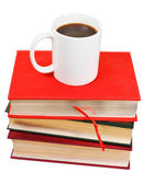 White mug of coffee on stack of books — Stock fotografie
