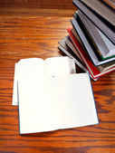 Open books on wooden table — Stock Photo