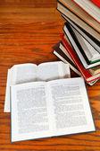 Open books on wooden table — Fotografia Stock