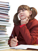 Schoolgirl, schoolwork and stack of books — Stockfoto