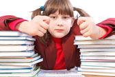 Schoolgirl, schoolwork and stack of books — Stock Photo