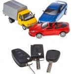 Three vehicle keys and model cars — Stock Photo
