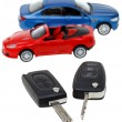 Stock Photo: Two vehicle keys close up and model cars