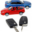 Two vehicle keys close up and model cars — Stock Photo #38624659