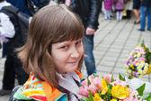 Schoolgirl with bouquet of flowers — Stock Photo