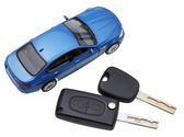 Above view of two vehicle keys and model car — Stock Photo