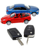 Two vehicle keys close up and model cars — Stock Photo