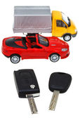 Two vehicle keys and model truck and car — Stok fotoğraf
