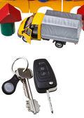 Door, vehicle keys, truck model and block house — Stock Photo
