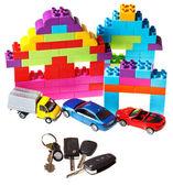 Keys, model car, plastic block house — Stock Photo