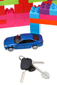Keys, model car, plastic block house — Stock Photo