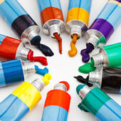 Multicolored tubes with squeezed watercolors — Stock Photo