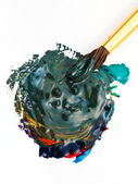 Paintbrush blends multicolored watercolors — Stock Photo