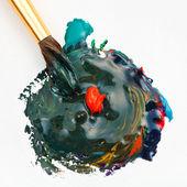 Paintbrush blends multicolored watercolors — Stock fotografie