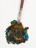 Fan paintbrush blends multicolored watercolors — Stock Photo