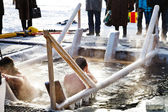 Ice swimming in Epiphany Day — Stock Photo