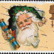 Father Christmas with Traditional Cracker — Stock Photo #39462699