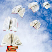Books fly out of pile of books — Photo
