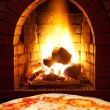 Pizza margherita and open fire in oven — Stock Photo #39782789