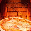 Pizza margherita and hot brick wall of oven — Stock Photo #39782969