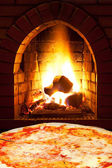 Pizza margherita and open fire in oven — Stock Photo