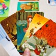 Stock Photo: Dixit game cards in hand