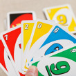 Stock Photo: Uno card game played with specially printed deck