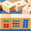 Stock Photo: Wood tiles closeup in mahjong game on blue cloth