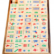 Stock Photo: Above view of wood mahjong game tiles in box