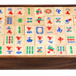 Stock Photo: Mahjong game tiles in box isolated on white