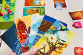 Playing in Dixit card game — Stock Photo