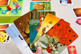 Dixit game cards in hand — Stock Photo