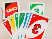 Uno card game pack in hand — Stock Photo