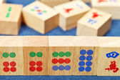 Wood tiles closeup in mahjong game on blue cloth — Stock Photo