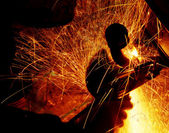 Sparks during welding car bottom — Stock Photo