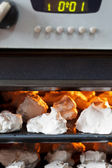 Preparing of sweet dessert meringue in oven — Foto Stock