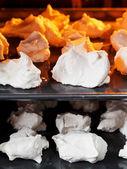 Cooking of sweet dessert meringue on oven trays — Stock Photo