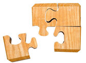 Pieces of wooden mechanical puzzle — Stock Photo