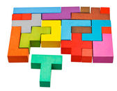 Multicoloured puzzle blocks and T-shaped piece — Stock Photo
