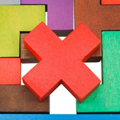 Cross shaped piece on wood puzzle close up — Stock Photo