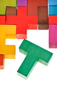 T-shaped piece in wooden multicoloured puzzle — Stock Photo