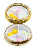 Compact pill box with mirror and several tablets — Stock Photo