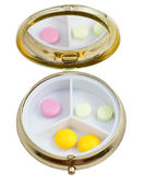 Compact pill box with several tablets — Stock Photo