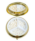Compact pill box with mirror and homeopathy balls — Stock Photo